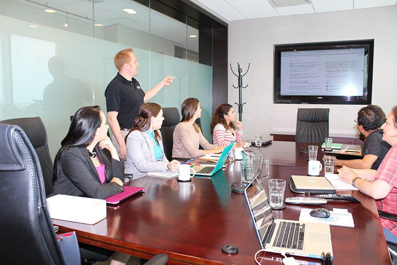 Photo of people getting training on online marketing